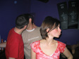 Pictures: Truro, April 2003 - Hannah in the foreground, Bracey and Poland snogging in the background.  L2 in Truro.