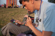 Thumbnail: Glastonbury 2009 - Tom trying to work out timetables and schedules.