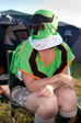 Pictures: Glastonbury 2009 - Libby wearing the Power Ranger suit.  I need to fix the sky in this picture.  Edit: half-done, that'll do